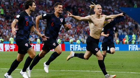 Croatia's Domagoj Vida, right, celebrates with his teammates after scoring his side's second goalduring the quarterfinal match between Russia and Croatia at the 2018 soccer World Cup in the Fisht Stadium, in Sochi, Russia, Saturday, July 7, 2018. (AP Photo/Manu Fernandez)