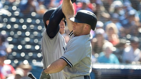 New York Yankees' Brett Gardner, right, is greeted by teammate Aaron Judge after hitting a home run in the first inning of a baseball game against the Toronto Blue Jays, Saturday, July 7, 2018, in Toronto. (Fred Thornhill/The Canadian Press via AP)