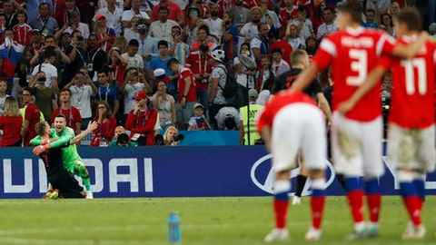Croatia goalkeeper Danijel Subasic, right, celebrates Ivan Rakitic at the end of the quarterfinal match between Russia and Croatia at the 2018 soccer World Cup in the Fisht Stadium, in Sochi, Russia, Saturday, July 7, 2018. (AP Photo/Rebecca Blackwell)