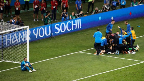 Russia goalkeeper Igor Akinfeev, left, reacts as Croatia players celebrate after scoring the winning penalty during the quarterfinal match between Russia and Croatia at the 2018 soccer World Cup at the Fisht Stadium in Sochi, Russia, Saturday, July 7, 2018. (AP Photo/Alexander Zemlianichenko)