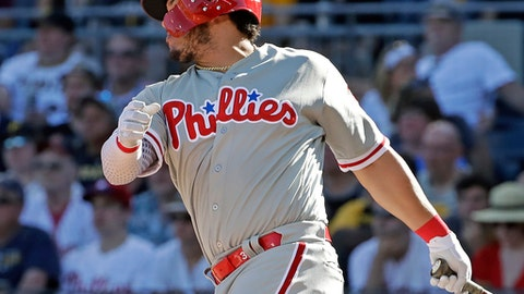 Philadelphia Phillies' Jorge Alfaro drives in a run with a double off Pittsburgh Pirates relief pitcher Edgar Santana in the seventh inning of a baseball game in Pittsburgh, Saturday, July 7, 2018. (AP Photo/Gene J. Puskar)