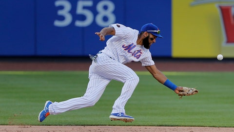 New York Mets shortstop Amed Rosario cannott make the play on a base hit by Tampa Bay Rays' Wilson Ramos during the ninth inning of a baseball game, Saturday, July 7, 2018, in New York. Joey Wendle scored on the play. (AP Photo/Julie Jacobson)