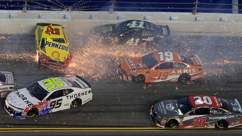 Joey Logano (22) hits the wall as he is involved in a multi-car crash also involving Kasey Kahne (95), Kurt Busch (41), Daniel Suarez (19), Erik Jones (20) and others during the NASCAR Cup Series auto race at Daytona International Speedway, Saturday, July 7, 2018, in Daytona Beach, Fla. (AP Photo/Ron Sander)