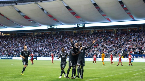 Vancouver Whitecaps' Kei Kamara, front right, celebrates his second goal against the Chicago Fire with his teammates, during the second half of a Major League Soccer match Saturday, July 7, 2018, in Vancouver, British Columbia. (Darryl Dyck/The Canadian Press via AP)