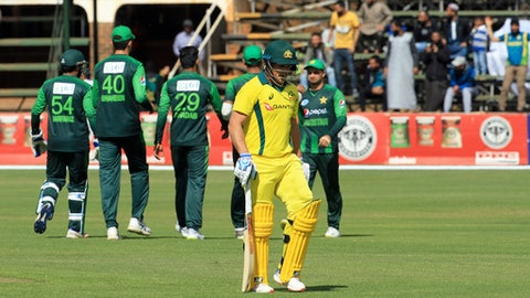 Australian capatin Aaron Finch walks off the pitch after been dismissed on the final day of the T20 cricket match between Australia and Pakistan at the Harare Sports Club, in Harare, Sunday, July, 8, 2018. (AP Photo/Tsvangirayi Mukwazhi)