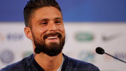 France's Olivier Giroud smiles as he answers journalists during a press conference at the 2018 soccer World Cup in Istra, Russia, Sunday, July 8, 2018. (AP Photo/David Vincent)
