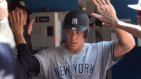 New York Yankees' Aaron Judge in the dugout after scoring against the Toronto Blue Jays in the first inning of a baseball game in Toronto, Sunday, July 8, 2018. (Fred Thornhill/The Canadian Press via AP)