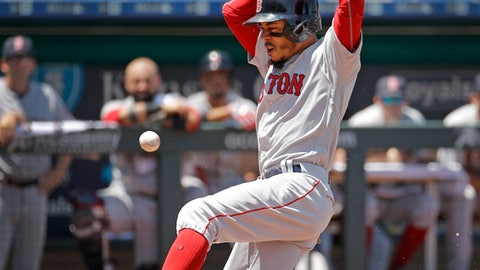 Boston Red Sox's Mookie Betts slides home to score on a sacrifice fly by Steve Pearce during the third inning of a baseball game against the Kansas City Royals, Sunday, July 8, 2018, in Kansas City, Mo. (AP Photo/Charlie Riedel)