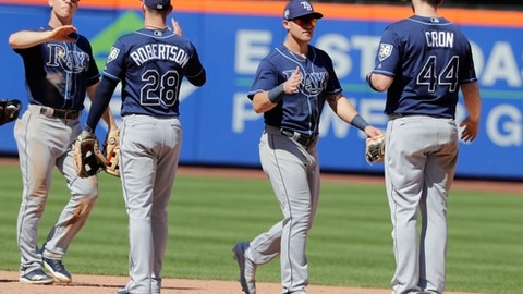 Tampa Bay Rays' C.J. Cron (44) and Daniel Robertson (28) celebrate with teammates after a baseball game against the New York Mets, Sunday, July 8, 2018, in New York. (AP Photo/Frank Franklin II)