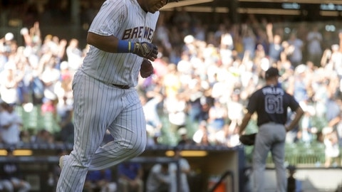 Milwaukee Brewers' Jesus Aguilar hits a three-run home run during the eighth inning of a baseball game against the Atlanta Braves Sunday, July 8, 2018, in Milwaukee. (AP Photo/Morry Gash)