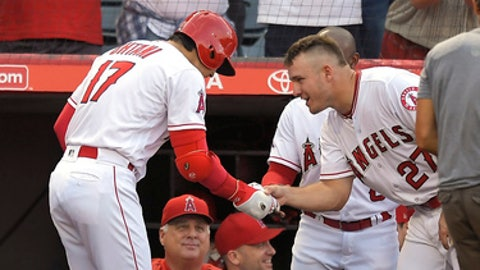 Los Angeles Angels' Shohei Ohtani, left, of Japan, and Mike Trout bow to each other after Ohtani hit a solo home run during the seventh inning of a baseball game against the Los Angeles Dodgers, Sunday, July 8, 2018, in Anaheim, Calif. (AP Photo/Mark J. Terrill)
