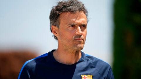 FILE - In this Friday, May 26, 2017 file photo, FC Barcelona's coach Luis Enrique attends a press conference at the Sports Center FC Barcelona Joan Gamper in Sant Joan Despi, Spain. Spain's football federation on Monday, July 9, 2018 says former Barcelona coach Luis Enrique has been appointed to take charge of the national team. He replaces Julen Lopetegui who was sacked on the eve of the World Cup after accepting the job at Real Madrid. (AP Photo/Manu Fernandez, file)