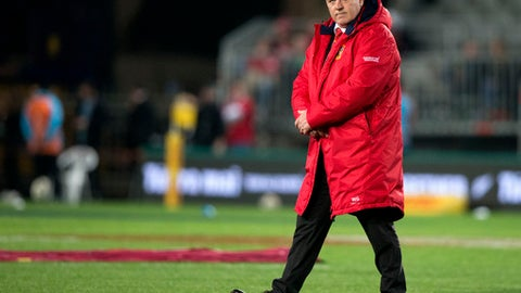 FILE - In this Saturday, July 8, 2017 file photo, British and Irish Lions head coach Warren Gatland walks on the field in Auckland, New Zealand. The Welsh Rugby Union says on Monday, July 9, 2018 former New Zealand police constable Wayne Pivac will take over from Warren Gatland as coach of the national team after next year's World Cup. Pivac has performed the same role at the Scarlets since 2014. (AP Photo/Mark Baker, file)