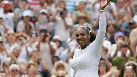 Serena Williams of the United States celebrates winning her women's singles match against Russia's Evgeniya Rodina, on day seven of the Wimbledon Tennis Championships, in London, Monday July 9, 2018. (AP Photo/Tim Ireland)