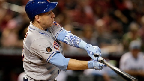 FILE - In this June 17, 2018, file photo, New York Mets' Todd Frazier hits an RBI-sacrifice fly-out in the first inning during a baseball game against the Arizona Diamondbacks in Phoenix. Frazier has been placed on the 10-day disabled list with a strained muscle in his left rib cage. (AP Photo/Rick Scuteri, File)