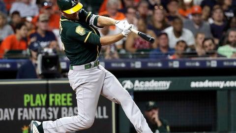 Oakland Athletics' Stephen Piscotty hits a home run against the Houston Astros during the seventh inning of a baseball game Monday, July 9, 2018, in Houston. (AP Photo/David J. Phillip)