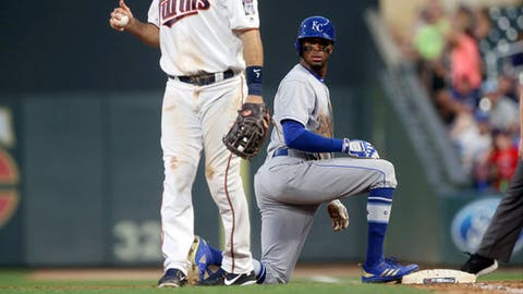 Kansas City Royals' Rosell Herrera looks back to the dugout after he was tagged out by Minnesota Twins first baseman Joe Bauer on a pickoff play in the sixth inning of a baseball game Monday, July 9, 2018, in Minneapolis. The out call was upheld after a Royals' challenge. (AP Photo/Jim Mone)
