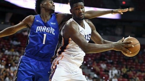 LAS VEGAS, NV - JULY 09:  Deandre Ayton #22 of the Phoenix Suns is guarded by Jonathan Isaac #1 of the Orlando Magic during the 2018 NBA Summer League at the Thomas & Mack Center on July 9, 2018 in Las Vegas, Nevada. The Suns defeated the Magic 71-53. (Photo by Ethan Miller/Getty Images)