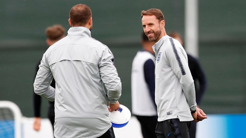 England head coach Gareth Southgate watches his players take part in a training session for the England team at the 2018 soccer World Cup, in the Spartak Zelenogorsk ground, Zelenogorsk near St. Petersburg, Russia, Tuesday, July 10, 2018. (AP Photo/Alastair Grant)