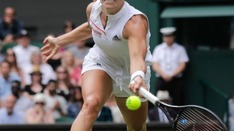 Germany's Angelique Kerber returns the ball to Russia's Daria Kasatkina, during their women's singles quarterfinals match at the Wimbledon Tennis Championships, in London, Tuesday July 10, 2018. (AP Photo/Ben Curtis)