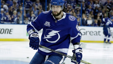 FILE - In this May 23, 2018, file photo, Tampa Bay Lightning right wing Nikita Kucherov warms up before Game 7 of the NHL Eastern Conference finals hockey playoff series against the Washington Capitals, in Tampa, Fla. The Lightning have signed forward Nikita Kucherov to an eight-year contract extension worth an average of $9.5 million in salary and annual bonuses. The team announced the deal Tuesday, July 10, 2018.(AP Photo/Chris O'Meara, File)