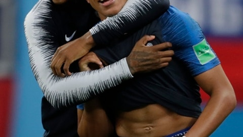 France's Kylian Mbappe, right, and Presnel Kimpembe celebrate at the end of the semifinal match between France and Belgium at the 2018 soccer World Cup in the St. Petersburg Stadium, in St. Petersburg, Russia, Tuesday, July 10, 2018. France won 1-0. (AP Photo/Petr David Josek)