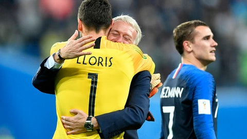 France goalkeeper Hugo Lloris celebrates with France head coach Didier Deschamps after their team advanced to the final after the semifinal match between France and Belgium at the 2018 soccer World Cup in the St. Petersburg Stadium in St. Petersburg, Russia, Tuesday, July 10, 2018. (AP Photo/Martin Meissner)