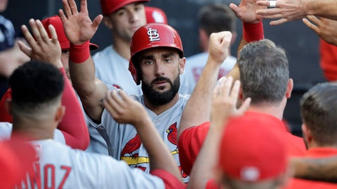 St. Louis Cardinals' Matt Carpenter celebrates in the dugout after scoring on a single by Jose Martinez during the third inning of a baseball game against the Chicago White Sox Tuesday, July 10, 2018, in Chicago. (AP Photo/Charles Rex Arbogast)