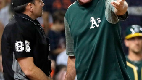 Oakland Athletics manager Bob Melvin argues with home plate umpire David Rackley during the fourth inning of the team's baseball game against the Houston Astros on Tuesday, July 10, 2018, in Houston. Melvin was ejected. (AP Photo/David J. Phillip)