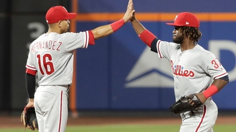Philadelphia Phillies' Odubel Herrera (37) celebrates with Cesar Hernandez (16) after the Phillies defeated the New York Mets 7-3 in a baseball game Tuesday, July 10, 2018, in New York. (AP Photo/Frank Franklin II)