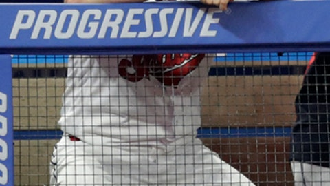 Cleveland Indians starting pitcher Trevor Bauer watches from the dugout during the ninth inning of the team's baseball game against the Cincinnati Reds, Tuesday, July 10, 2018, in Cleveland. The Reds won 7-4. (AP Photo/Tony Dejak)