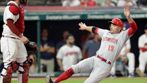 Cincinnati Reds' Joey Votto, right, scores as Cleveland Indians catcher Roberto Perez watches during the ninth inning of a baseball game Tuesday, July 10, 2018, in Cleveland. The Reds won 7-4. (AP Photo/Tony Dejak)