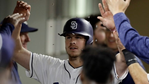 San Diego padres throw sunflower seeds as Wil Myers is greeted in the dugout after hitting a home run during the fifth inning of a baseball game against the Los Angeles Dodgers on Tuesday, July 10, 2018, in San Diego. (AP Photo/Gregory Bull)
