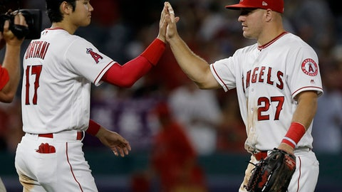 Los Angeles Angels designated hitter Shohei Ohtani, left, of Japan, celebrates with Mike Trout after their team defeated the Seattle Mariners 9-3 in a baseball game in Anaheim, Calif., Tuesday, July 10, 2018. (AP Photo/Alex Gallardo)