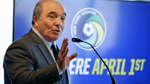 FILE - In this March 21, 2017 file photo, new owner of the New York Cosmos, Rocco Commisso, speaks to reporters during a news conference in the Brooklyn borough of New York. Former owner Li Yonghong missed the deadline of Friday, July 6, 2018 to repay part of a loan worth more than 300 million euros from the U.S.-based hedge fund and Elliott has repossessed the holding company in Luxembourg that Li used to buy seven-time European champion Milan in April 2017. Commisso said last week that he is still keen to buy AC Milan. (AP Photo/Seth Wenig, files)