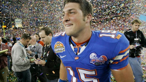 FILE - In this Jan. 8, 2007, file photo, Florida quarterback Tim Tebow celebrates his team's 41-14 victory over Ohio State at the BCS national championship football game in Glendale, Ariz.  Two-time national champion and 2007 Heisman Trophy winner Tim Tebow will be inducted into the team's ring of honor, becoming the sixth player to receive the honor. The school announced Wednesday, July 11, 2018, that Tebow will be recognized during the LSU-Florida game on Oct. 6, 2018. (AP Photo/Matt York, File)