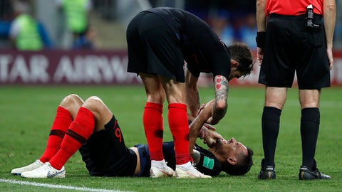 Croatia's Dejan Lovren lies on the pitch during the semifinal match between Croatia and England at the 2018 soccer World Cup in the Luzhniki Stadium in Moscow, Russia, Wednesday, July 11, 2018. (AP Photo/Rebecca Blackwell)