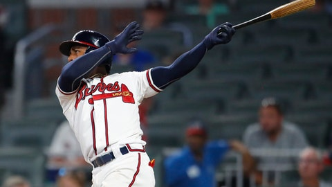 Atlanta Braves' Ozzie Albies watches his two-run home run in the eighth inning of a baseball game against the Toronto Blue Jays, Wednesday, July 11, 2018, in Atlanta. (AP Photo/Todd Kirkland)