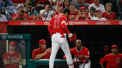 Los Angeles Angels' Shohei Ohtani walks into the dugout after striking out during the ninth inning of a baseball game against the Seattle Mariners, Wednesday, July 11, 2018, in Anaheim, Calif. The Mariners won 3-0. (AP Photo/Jae C. Hong)