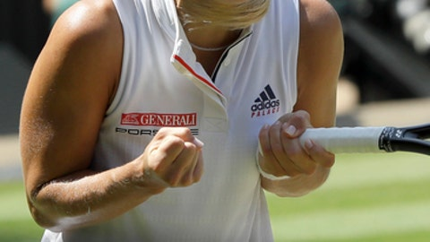 Germany's Angelique Kerber celebrates defeating Latvia's Jelena Ostapenko during their women's singles semifinals match at the Wimbledon Tennis Championships, in London, Thursday July 12, 2018.(AP Photo/Kirsty Wigglesworth)