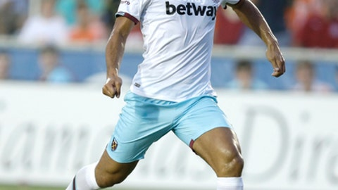 FILE - In this file photo dated Tuesday, July 12, 2016, West Ham United's Winston Reid moves in to take a shot and score against the Carolina Railhawks in the first half of an international friendly soccer match in Cary, N.C.,USA.  Reid returned to London from a preseason training camp in Switzerland, but it is announced Thursday July 12, 2018, he is to undergo follow-up operations on injuries suffered last season.(AP Photo/Gerry Broome, FILE)