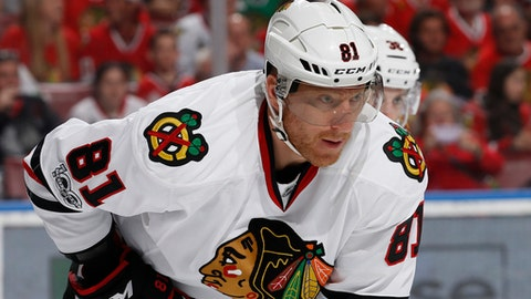FILE - In this March 25, 2017, file photo, Chicago Blackhawks right wing Marian Hossa (81) prepares for a face off against the Florida Panthers during the first period of an NHL hockey game, in Sunrise, Fla. The Chicago Blackhawks have traded Marian Hossa and Vinnie Hinostroza Thursday, July 12, 2018, in a blockbuster deal with the Arizona Coyotes, parting with a promising young forward in order to clear out a troublesome contract.  The Blackhawks also sent defenseman Jordan Oesterle and a third-round pick in the 2019 draft to the Coyotes for forwards Marcus Kruger, MacKenzie Entwistle and Jordan Maletta, defenseman Andrew Campbell and a fifth-round pick in next years draft.  (AP Photo/Joel Auerbach, File)