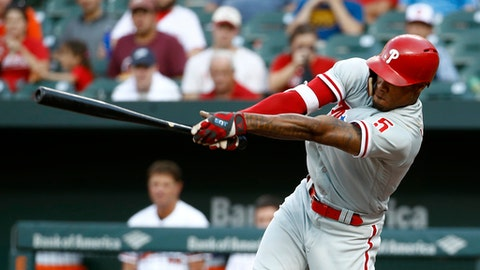 Philadelphia Phillies' Nick Williams hits a ground ball during the third inning of the team's baseball game against the Baltimore Orioles, Thursday, July 12, 2018, in Baltimore. Cesar Hernandez scored on the play. (AP Photo/Patrick Semansky)