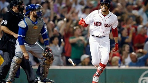 Boston Red Sox's Mookie Betts reacts in front of Toronto Blue Jays' Russell Martin, left, after hitting a grand slam during the fourth inning of a baseball game in Boston, Thursday, July 12, 2018. (AP Photo/Michael Dwyer)