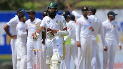South Africa's Hashim Amla reacts as he leaves the ground after losing his wicket during the second day of their first test cricket match against Sri Lanka in Galle, Sri Lanka, Friday, July 13, 2018. (AP Photo/Eranga Jayawardena)