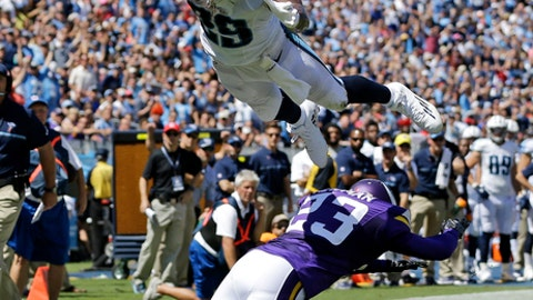 FILE - In this Sept. 11, 2016, file photo, Tennessee Titans running back DeMarco Murray (29) dives over Minnesota Vikings cornerback Terence Newman (23) to score a touchdown on a 6-yard pass reception in the first half of an NFL football game, in Nashville, Tenn. DeMarco Murray is retiring from the NFL. The 2014 Offensive Player of the Year made the announcement on ESPN on Friday, July 13, 2018, four months after being released by the  Titans.(AP Photo/Weston Kenney, File)