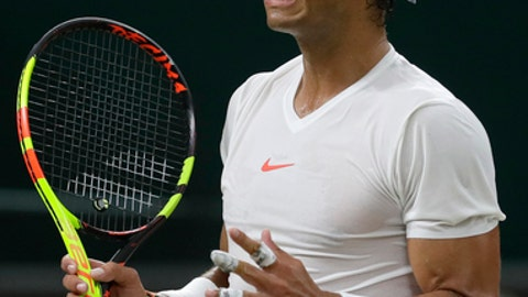 Rafael Nadal of Spain reacts after losing a point during his men's singles semifinals match against Serbia's Novak Djokovic, at the Wimbledon Tennis Championships, in London, Friday July 13, 2018.(AP Photo/Kirsty Wigglesworth)
