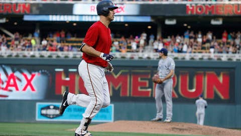 Minnesota Twins' Joe Mauer jogs home on a three-run home run off Tampa Bay Ray pitcher Nathan Eovaldi, right, during the third inning of a baseball game Friday, July 13, 2018, in Minneapolis. (AP Photo/Jim Mone)