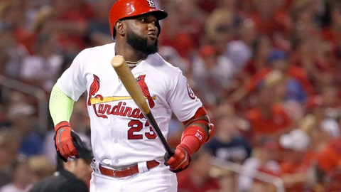 St. Louis Cardinals' Marcell Ozuna reacts after flying out during the sixth inning of the team's baseball game against the Cincinnati Reds on Friday, July 13, 2018, in St. Louis. (AP Photo/Jeff Roberson)
