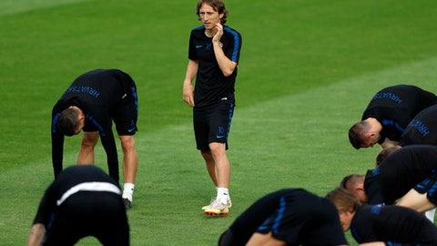 Croatia's Luka Modric looks at his teammates during a training session of Croatia at the 2018 soccer World Cup in Moscow, Russia, Saturday, July 14, 2018. (AP Photo/Darko Bandic)